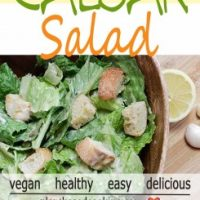 Vegan Caesar Salad in wood salad bowl with ceasar dressing in glass container