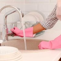 Woman Washing Dishes with pink gloves