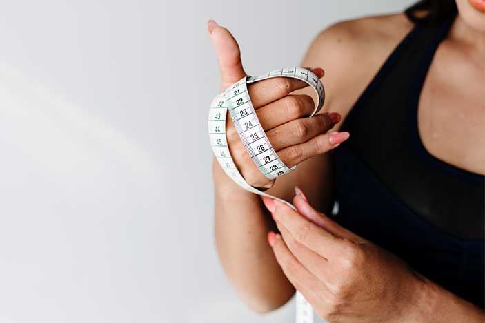 Woman Tape Measure