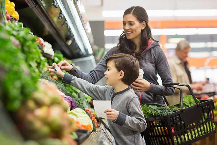 Kid Shopping for Veggies