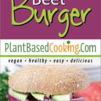 Black Bean Beet Burger on bun with tomato, lettuce, pickles, red onion, avacodo