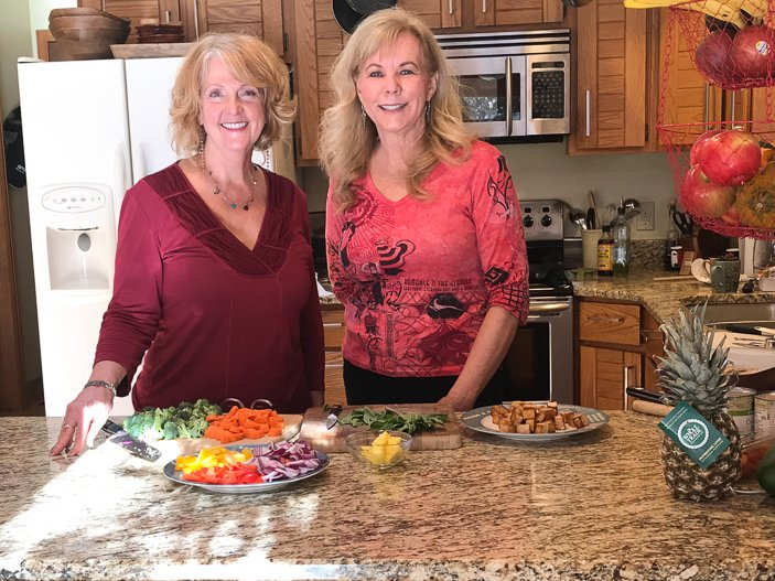 Diane and Melody standing at the kitchen counter
