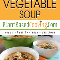 Pot of hearty vegetable soup served in two white bowls