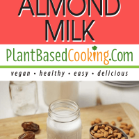 fresh homemade almond milk in a mason jar sitting on cutting board with ingredients