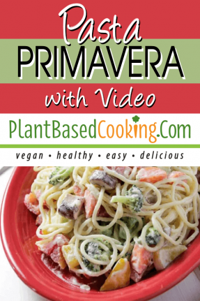 Pasta Primavera on red serving dish