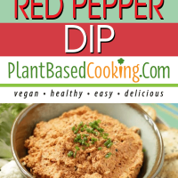 Roasted Red Pepper Dip in bowl served with cauliflower florets, crackers