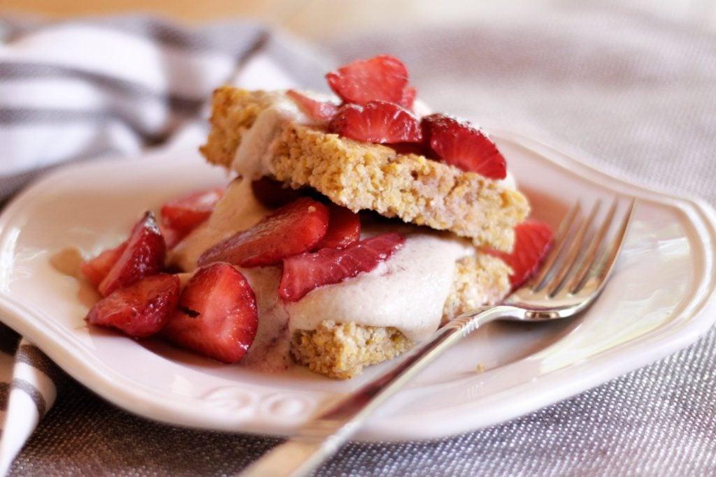Strawberries with vegan cream on cornbread