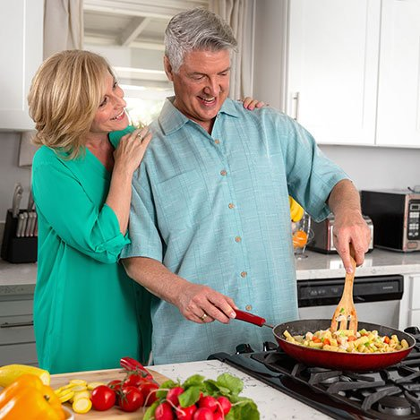 Couple cooking in kitchen