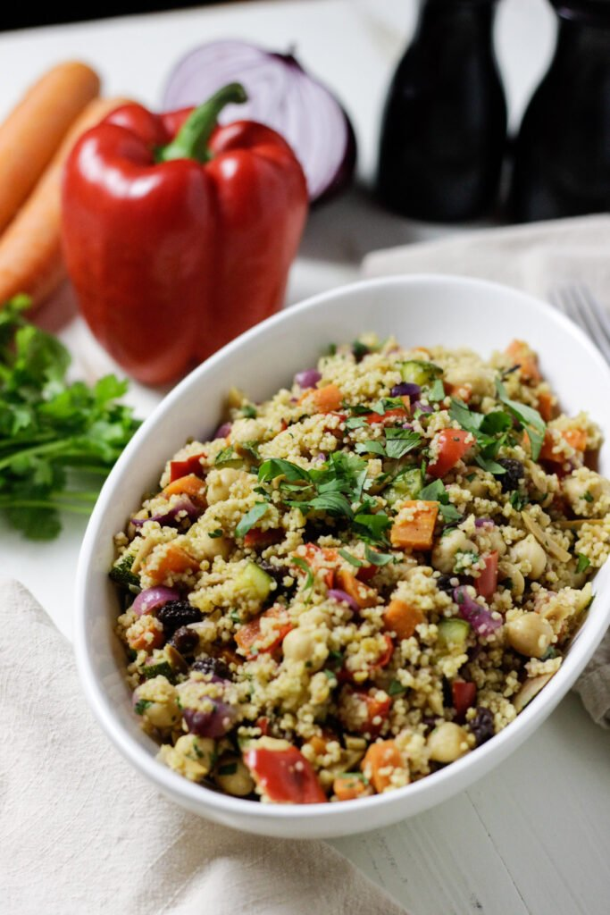 Moroccan couscous salad in white bowl